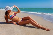 Sexy Beautiful Woman In Color Swimwear And Hat At The Sea Coast. Exotic Country Travel And Rest Conc poster