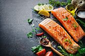 Fresh salmon fillet with aromatic herbs, spices and vegetables. Balanced diet or cooking concept poster