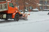Snow Clearing. Tractor Clears The Way After Heavy Snowfall. poster