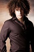 young curly man portrait wearing shirt  studio shot