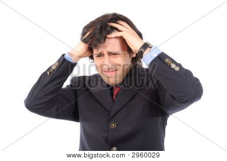 Worried Young Businessman Pulling The Hair