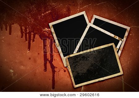 old instant photo photo frames on bloody grunge background