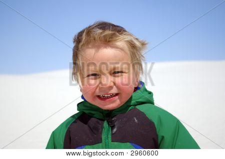 Portrait Of A Cute Little Boy In Windy Weather
