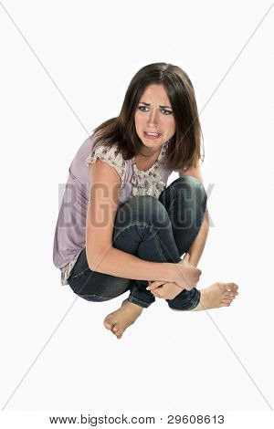 picture of offended girl sitting isolated on white