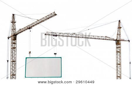 two yellow hoisting cranes and advertisement hoarding isolate on white background
