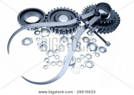 Calipers, nuts and cogwheels on plain background