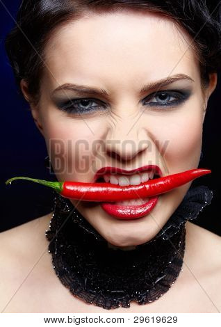 Beautiful Brunette Woman With Red Chilli Pepper