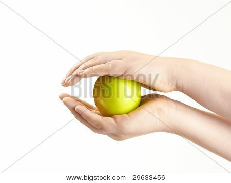 Apple sandwiched between childs hands