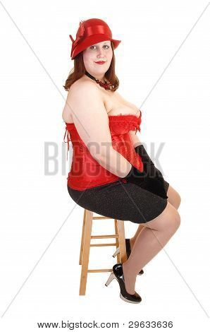 Girl Sitting In Corset.