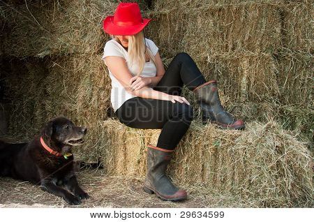 Contry girl with old black dog