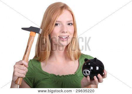 blonde with piggy-bank and hammer