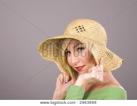 Blonde Straw Hat Over Ears
