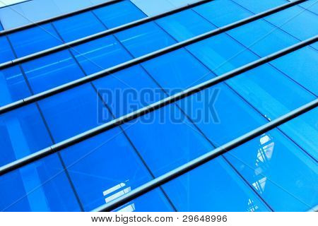 Glass wall of modern industrial building, may be used as background