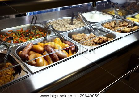 Hot trays with cooked food  in dining room
