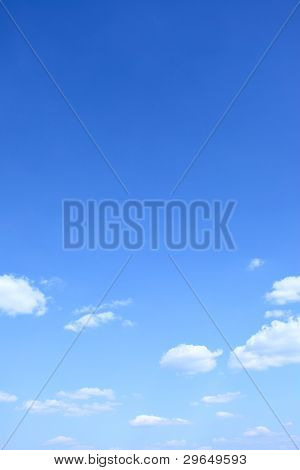 Blue sky and clouds with space for text above