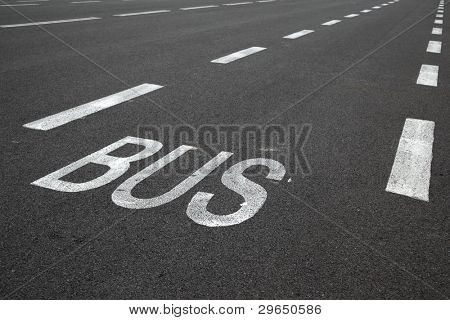Road marking over black asphalt of carriageway