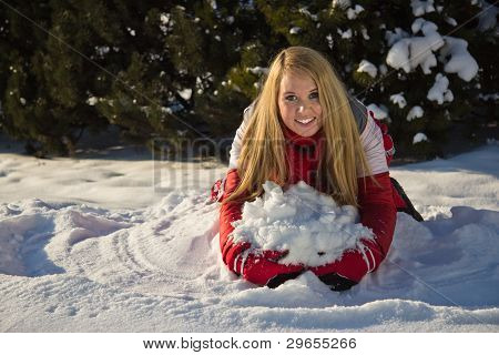 Woman Building A Snow Pile