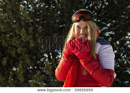 Woman Holding A Red Cup Close To Face Outdoors At Winter