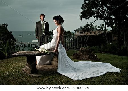 Bride Sitting With Dress Stretched Out Behind