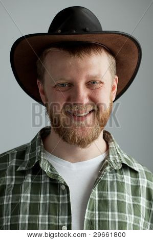The Good-natured Cowboy Hat And A Green Plaid Shirt
