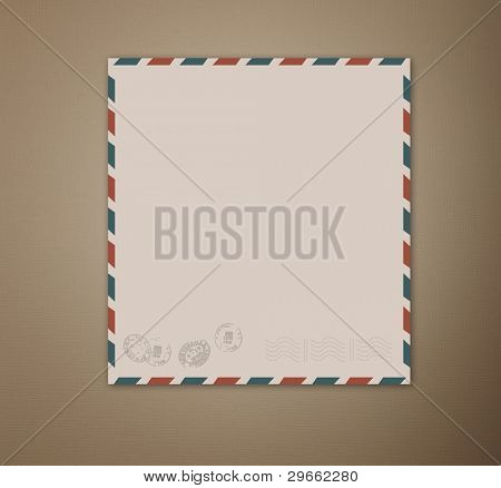 vintage airmail postcard. grungy paper background