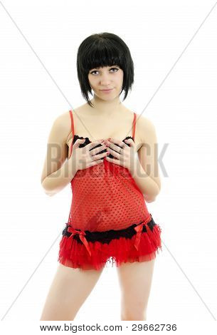 Brunette Posing In Red Lingerie. Isolated On White Background.