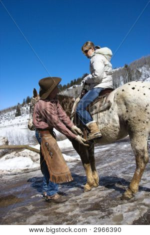 Wrangler Helping With Horse.
