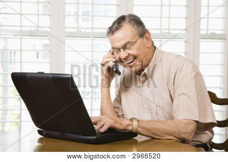 Mature Man With Laptop.