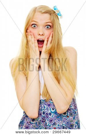 Wondered pretty blonde teenager with wide open eyes and mouth standing and holding hands near her face. Mask included