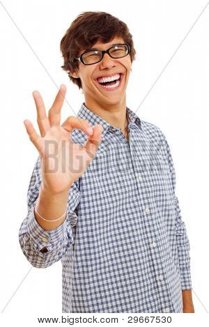 Smiling young man with glasses wearing checkered shirt shows Ok symbol. Isolated on white background, mask included