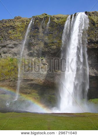 Skogafoss waterfall with rainbow, Iceland.