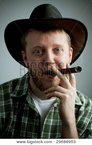 Red-bearded Man In A Cowboy Hat And A Shirt