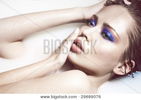 High fashion portrait of a sexy woman with creative makeup