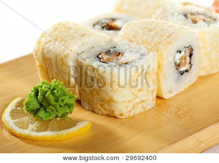 Omelet Maki Sushi - Roll made of Smoked Eel and Cream Cheese  inside. Tamago (Japanese Omelet) outside