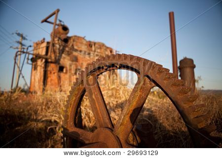mining artefacts historical old antique machinery, vintage remnants and industrial artifacts mechanical machine rusty and oxidated red rust
