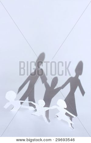 Paper People Chain: Man, Woman And Baby And Shadows From Them. Family Concept.