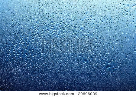 Blue Water Spray On Glass