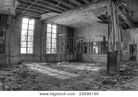 Inside an abandoned and decaying post office.
