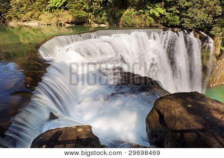 Shifen waterfall is located at Pingxi township in Taipei, Taiwan