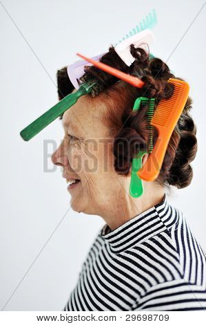Senior woman with many combs on hair
