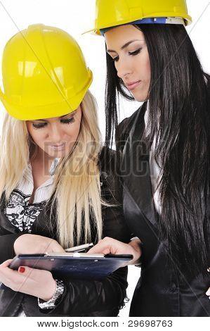 Two architect girls writing