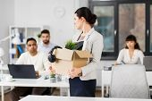 business, firing and job loss concept - sad fired female employee with box of personal stuff leaving poster