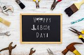 Labor Day Background Concept. Rusty Old Hand Tools With Blackboard And Text Writing Happy Labor Day! poster