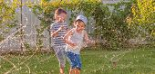 Happy Children Playing Outdoor. Joyful Siblings Having Fun On Sunny Summer Day. Happy Children Playi poster