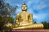 Buddha In The Wewurukannala Vihara Old Temple In The Town Of Dickwella, Sri Lanka. A 50m-high Seated poster