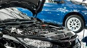 Car And Engine Service Concpet - Blurred Car Engine Room Checking Maintenance Sevice By Mechanical A poster