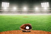 Baseball Glove On Field At Brightly Lit Outdoor Stadium. Focus On Foreground And Shallow Depth Of Fi poster