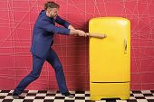 Man Formal Elegant Suit Beat With Wooden Bat Retro Vintage Yellow Refrigerator. Bachelor Hungry Want poster