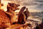 Gargoyles Or Chimeras On The Notre Dame De Paris Overlooking Paris, France. Old Cathedral Of Notre D poster