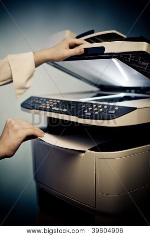 Woman's Hand With Copier